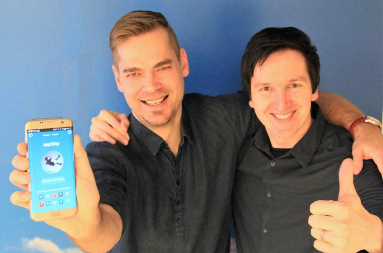 Teemu and Kari from Tecinspire showing App2Day on mobile